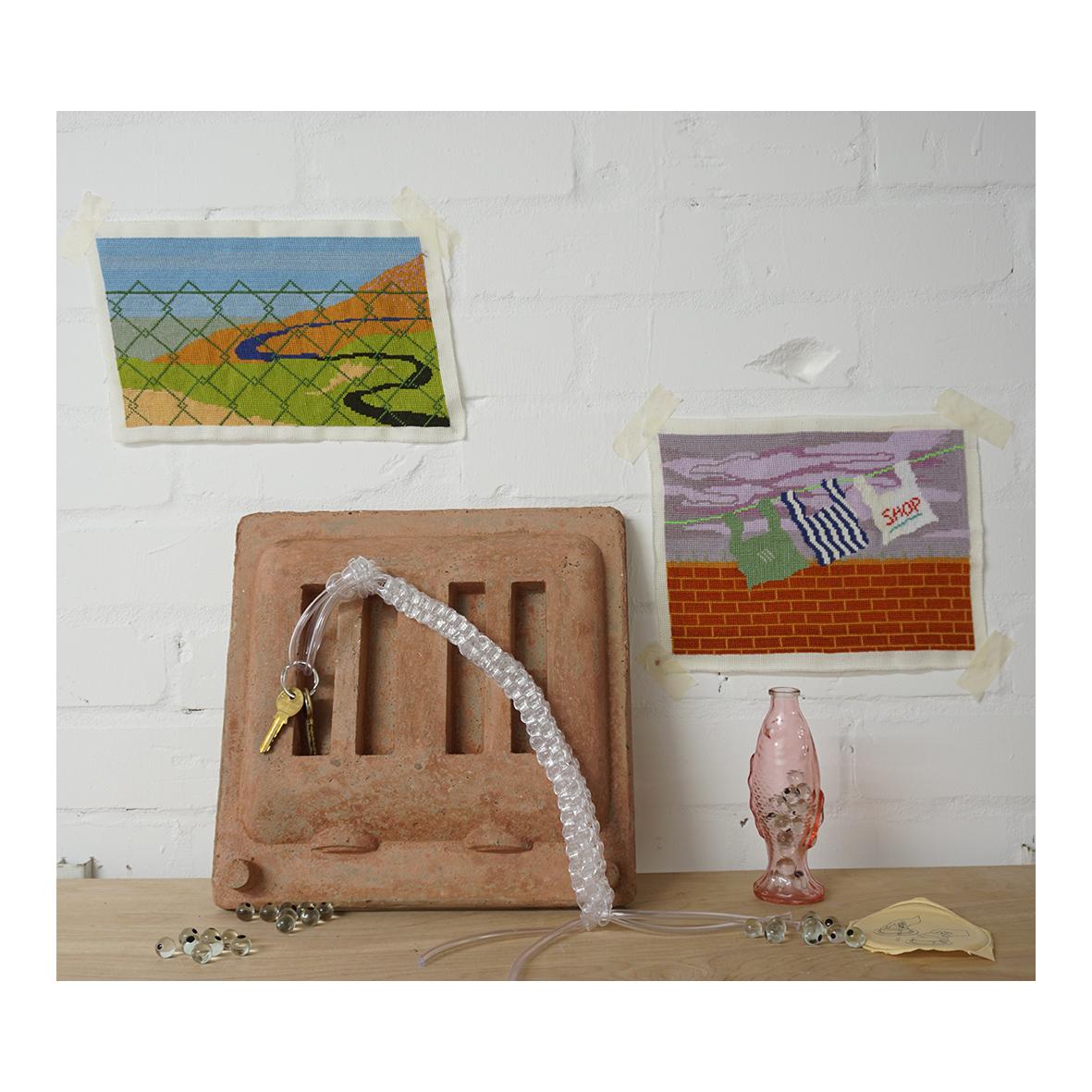 charlotte dawson art Inward, (2020) Cotton Embroidery, Concrete, PVC tubing, Glass, Enamel Paint, Vinegar soaked keys, Plastic disposable lid Dimensions variable