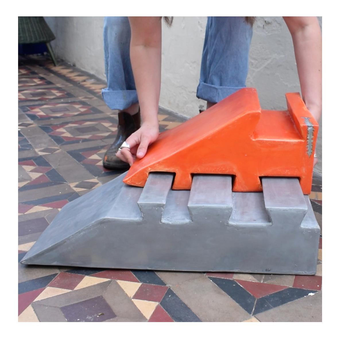 ellie__hayward Doorstop - Putting the Pieces Together, (2019/2020) Jesmonite, Pigment, Metal Powder, Aluminium Etching Plate. 60 x 36 x 29cm