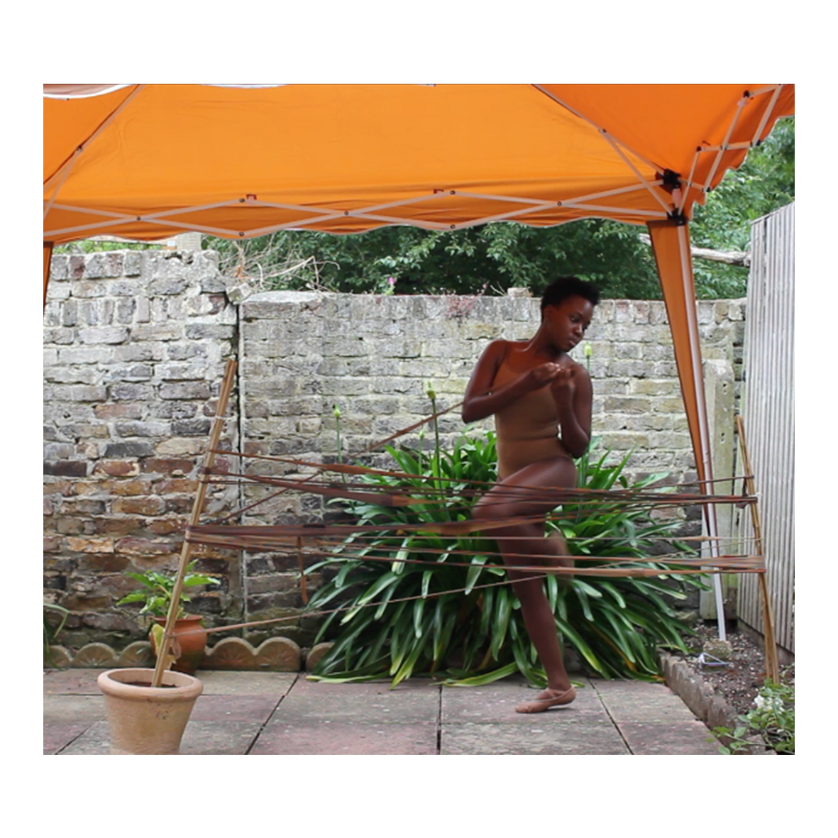 @enamdg (Enam Gbewonyo) Nude Me/Under the Skin: Unveiling our stories, one Black NHS Nurse at a time, (2019 - ) Bamboo sticks, used tights, wooden tights and individual artworks (Ekua Etsibah, Mrs Dawn Hill CBE, Mavis Gbewonyo, Olive Gbewonyo and Donna Simpson: Individual artwork mediums: printed family photographs on tea stained recycled paper, tea stained recycled card, used burnout tights, cotton thread, PVA glue and acrylic metallic paint
